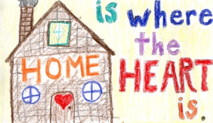 Child like drawing of house with words 'Home is where the heart is'